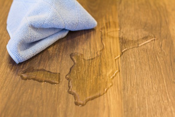 wipe spillage on laminate flooring immediately