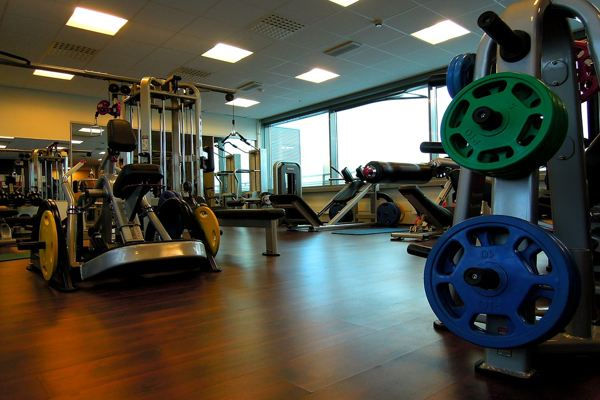 gym with laminate flooring